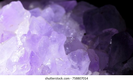 Violet amethyst lit from left and dark background