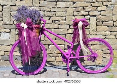 Violet bicycle decorated with levanders and laces