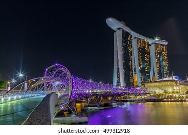 Violet bridge reflecting in the Singapore marina at night - 1