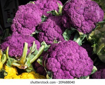 Violet cauliflowers for sale at a farmers market