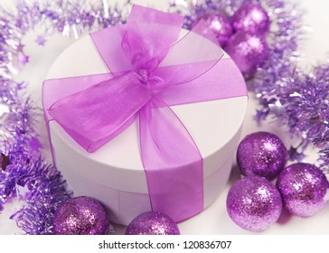 violet christmas present on white background