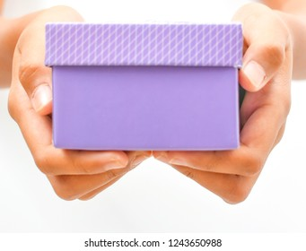 Violet gift box in girl hands isolated on white background. can used for the holidays present.