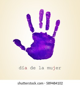 a violet handprint and the text dia de la mujer, womens day in spanish, on a beige background