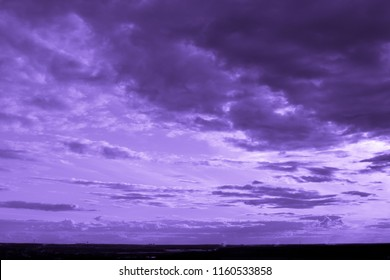 Violet landscape of the sky - clouds, horizon and earth
