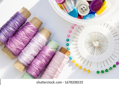 violet and pink threads and buttons