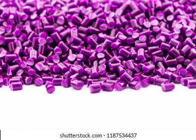 violet plastic resin ( Masterbatch ) on a white background