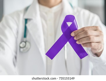 Violet purple ribbon awareness symbolic bow color in doctor's hand for Pancreatic cancer, Hodgkin's lymphoma, epilepsy and Testicular Cancer