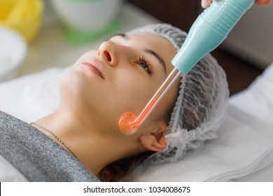Violet ray treatment on face at the beautician. A violet ray is an antique medical appliance used during the early 20th century in the obsolete medical therapy called electrotherapy.