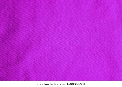 Violet texture background, smooth soft cloth pattern. Empty violet fabric background, seamless colorful material surface