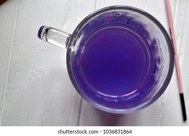 Violet water in the glass mug.