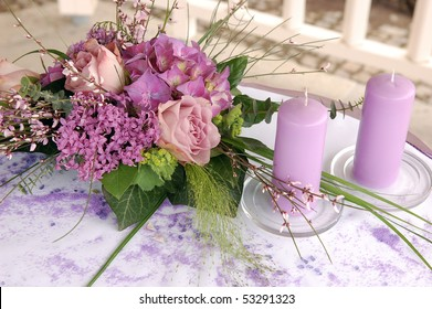 Violet wedding decoration with flowers and candles