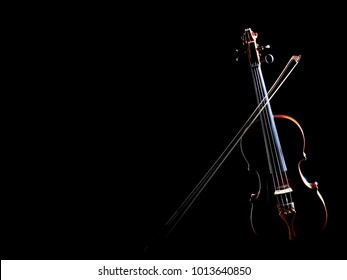 Violin with bow Classical music instruments of orchestra. Violin isolated on black background