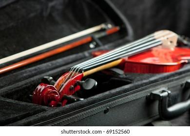 Violin and bow in dark black case