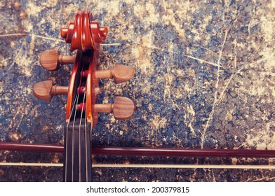Violin, bow and old book table