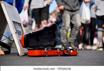 Violin case opens for donating money and coins on street, Buskers performing arts in public for money.
