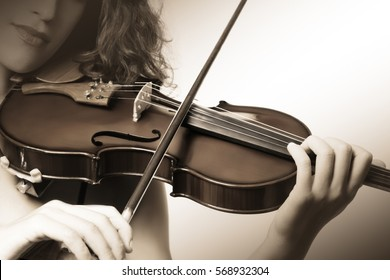 Violin close up hands Classical violinist playing musical instrument Violin player detail