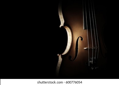 Violin closeup Musical instrument of orchestra. Silhouette violin isolated on black background close up