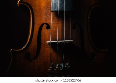 Violin closeup shot, selective focus isolated on black background