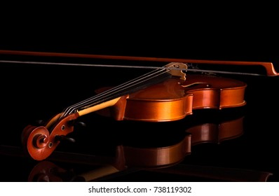 Violin end bow close-up isolated on black background