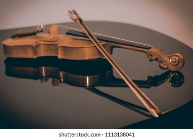 Violin and fiddle stick isolated