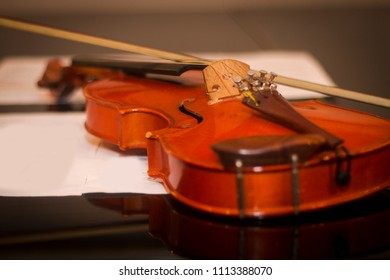 Violin and fiddle stick on the piano