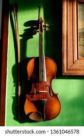 Violin with fiddle stick on the wall