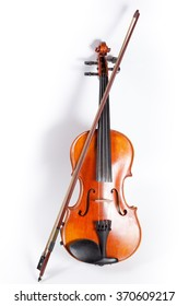 Violin in front of white background, isolated.