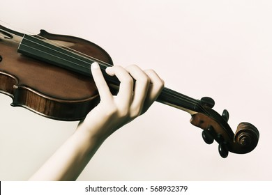 Violin with hands of violinist close up. Detail of violin player closeup musical instrument