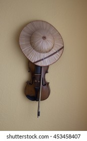 violin and hat hanging on wall. Music voyage
