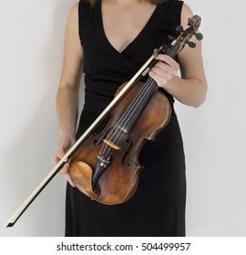 violin in his hands