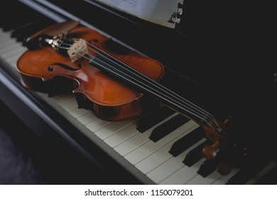 Violin instrument with piano