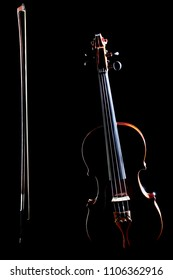 Violin isolated on black with bow. Classic music instrument of orchestra