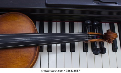 Violin isolated on piano background