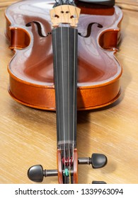 Violin, also known informally as a fiddle, is a wooden string instrument in the violin family. Most violins have a hollow wooden body.