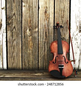 A Violin leaning on a wooden fence. Advertisement with room for text or copy space.