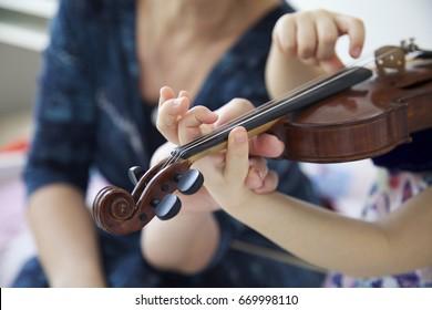Violin lesson.