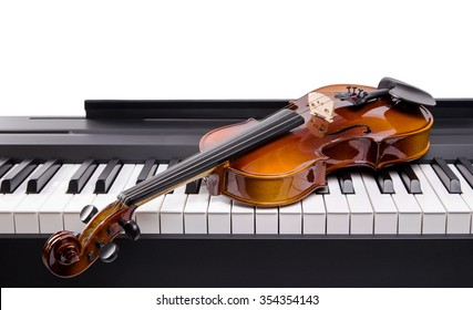 The violin lies on keys digital piano