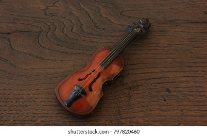 Violin miniature on wooden background