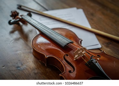 Violin and music sheet on wood table
