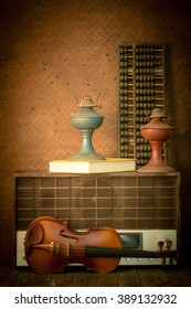 violin and old radio in vintage style on steel background