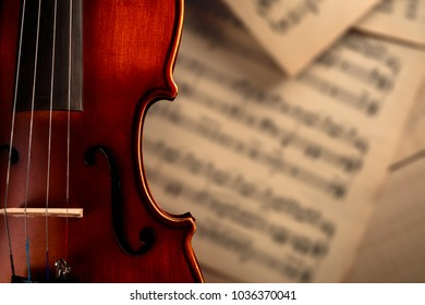 violin on the background of musical notes