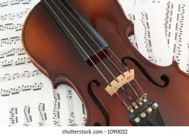 Violin on bed of sheet music