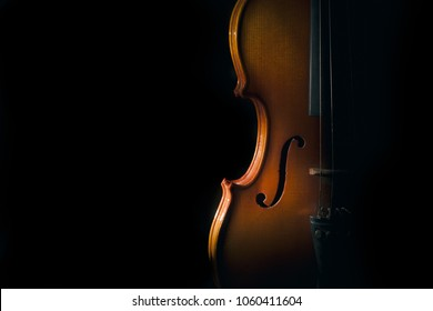 Violin on a black background with spot light.