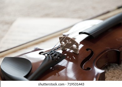 violin on carpet floor with music note