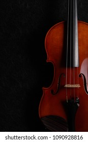 A violin on a dark background.