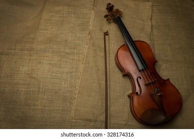 Violin on homespun fabric texture