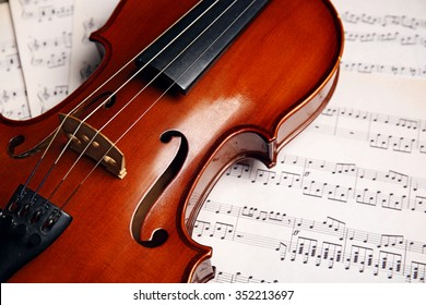 Violin on music papers background