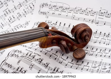 Violin on a pile of sheet music
