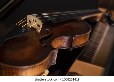 Violin on wooden brown background closeup