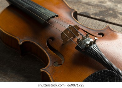 Violin on a wooden textured table
